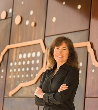 SUSAN REMPE is part of a multi-institution research team exploring a new approach to fighting cancer that avoids many of the side effects of current treatments.(Photo by Randy Montoya)