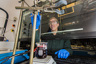 """Graham Yelton and Sandia colleagues have developed a single electroforming technique that tailors key factors to better thermoelectric performance: crystal orientation, crystal size and alloy uniformity. The work is outlined a paper, """"Using Galvanostatic Electroforming of Bi1-xSbx Nanowires to Control Composition, Crystallinity and Orientation,"""" in the Jan. 28 edition of the Materials Research Society's MRS Bulletin.(Photo by Randy Montoya)"""