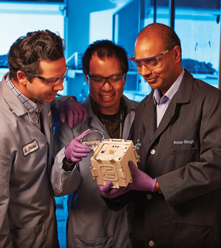 Matt Piccini (8621), left, Chung-Yan Koh (8621) and Anup Singh (8620) lead the SpinDx team. SpinDX is a diagnostic tool with medical and non-medical applications. (Photo by Jeff McMillan)