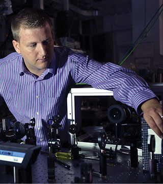 Sandia optical diagnostics researcher Christopher Kliewer has won a DOE Early Career Research award that will fund the development of new optical diagnostic tools to study interfacial combustion interactions, which are major sources of pollution and vehicle inefficiency.(Photo by Dino Vournas)