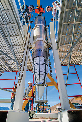 NOSE ASSEMBLY — The nose assembly of a mock B61-12, mounted on an aluminum tube to replicate the body of the bomb, sits in a stand awaiting movement to Sandia's Davis gun, which fired the test assembly into a pool in one of a series of impact tests.